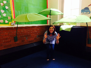 Rachel from Home Start gets excited as the reading corner starts taking shape!