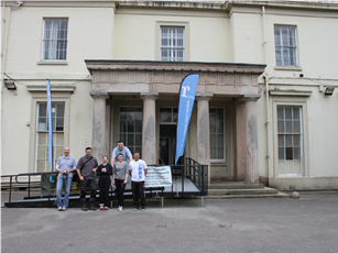 The team standing outside the mansion house (1)