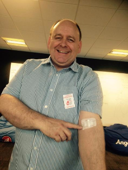 Alan back from the blood bank, and still smiling!